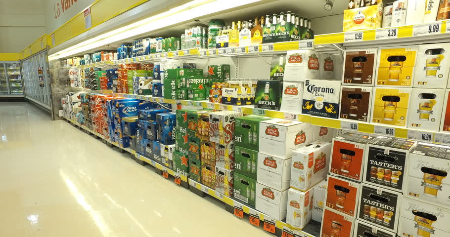MONTREAL, CANADA - NOVEMBER 2016: Smooth & steady shot of beer alcohol variety in supermarket
