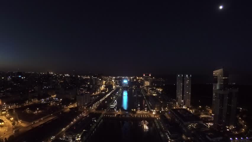 Puerto Madero harbor, Buenos Aires, at night, with restaurant buildings, a promenade, a museum ship and high-rise buildings of the city center