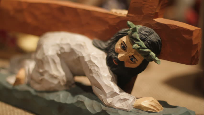 Wooden figure of Jesus Christ at store display