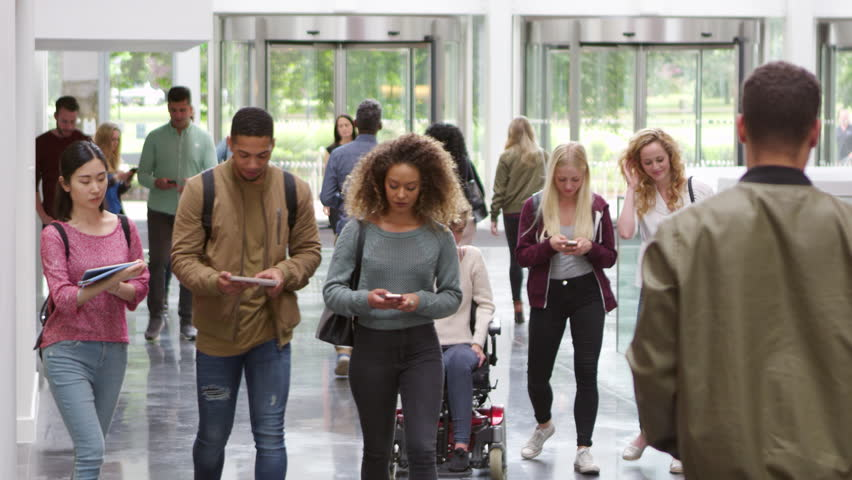Students walking through the foyer of a modern university, shot on R3D | Shutterstock HD Video #21195964