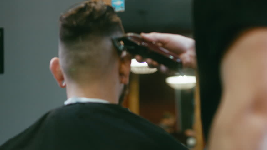 Young handsome bearded Caucasian man getting a haircut in a modern barber shop. 4K UHD Raw edited footage | Shutterstock HD Video #21196474