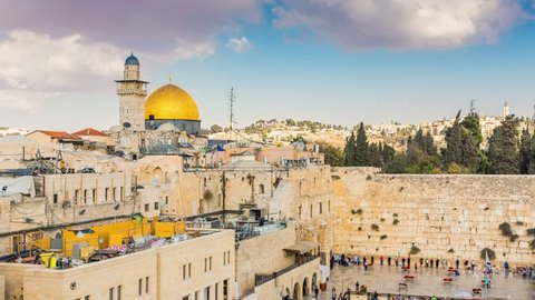 View to Western Wall known at the Wailing Wall or Kotel in Jerusalem is a major Jewish sacred place, Old city and the Temple Mount, Dome of the Rock and Al Aqsa Mosque - Time Lapse, Pan Right