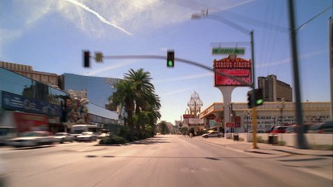 day Undercranked Process Plate Straight forward Down Las Vegas strip, passes Circus Circus Riviera FRONTIER Wynn TREASURE ISLAND Mirage Caesars Palace Flamingo Bally Paris Palms