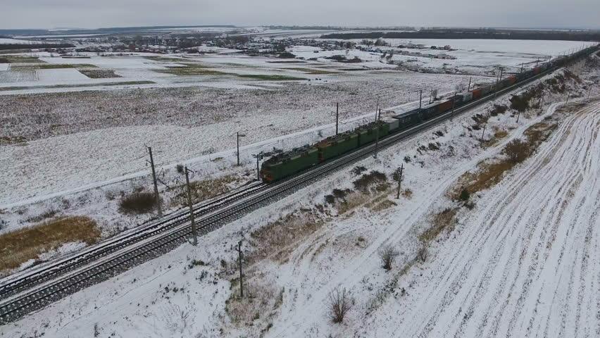 Aerial view of cargo train delivering goods, fuel, petrolium in winter. | Shutterstock HD Video #21221134