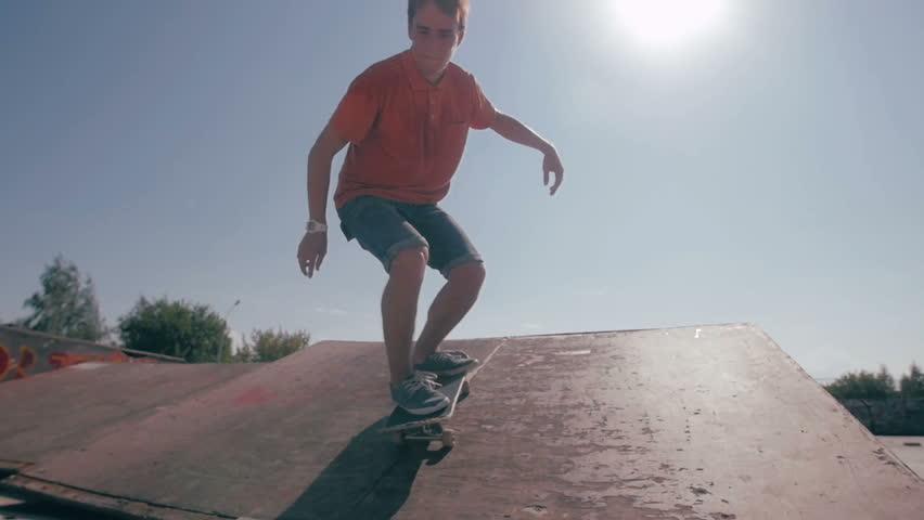 Skateboard fails. Skateboarder skateboarding and falling down doing tricks in a street. Slow motion.