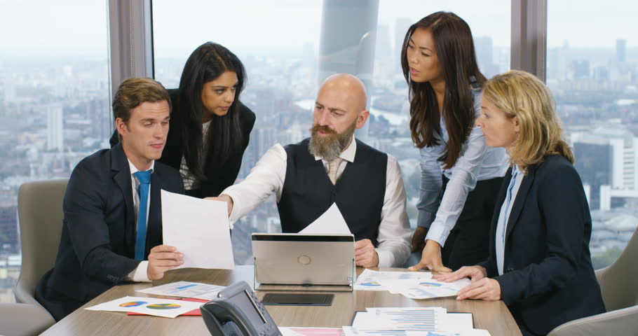 4k, Multi ethnic group of coworkers having a meeting in the boardroom with graphs, carts and laptop with London skyline in the background. Slow motion.   Shutterstock HD Video #21224956
