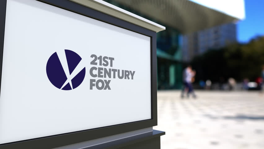 Street signage board with 21st Century Fox logo. Blurred office center and walking people background. Editorial 4K 3D rendering