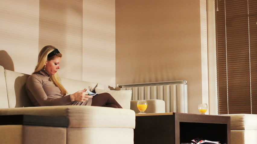 Young woman resting in luxury apartment | Shutterstock HD Video #2123774