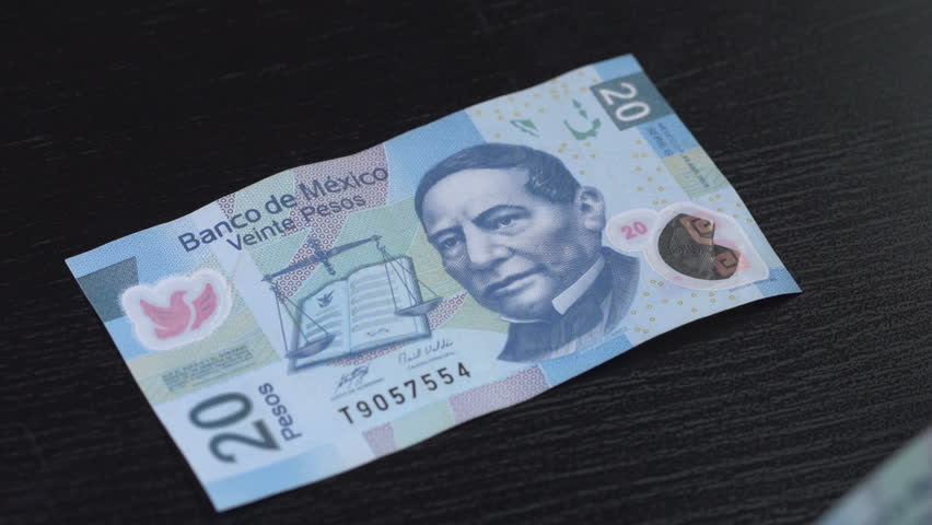 Mexican Pesos counted on a table