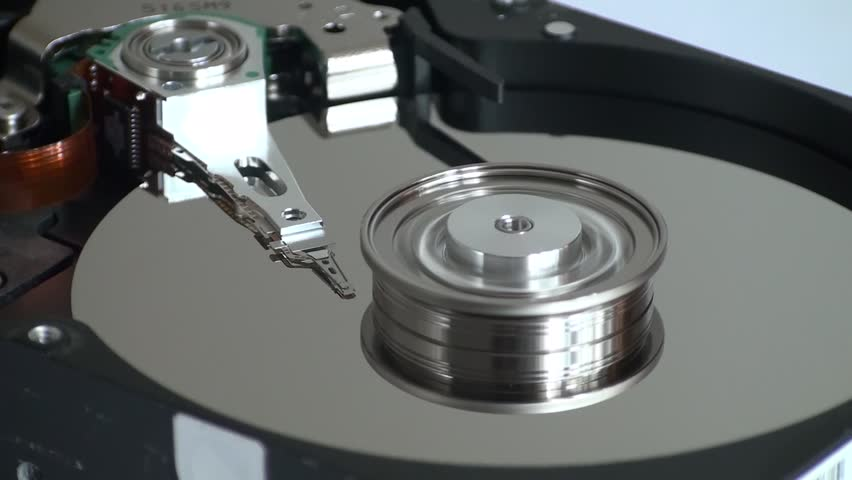 Metal circle plate and magnetic head inside hard disk drive reading and writing data | Shutterstock HD Video #21255604