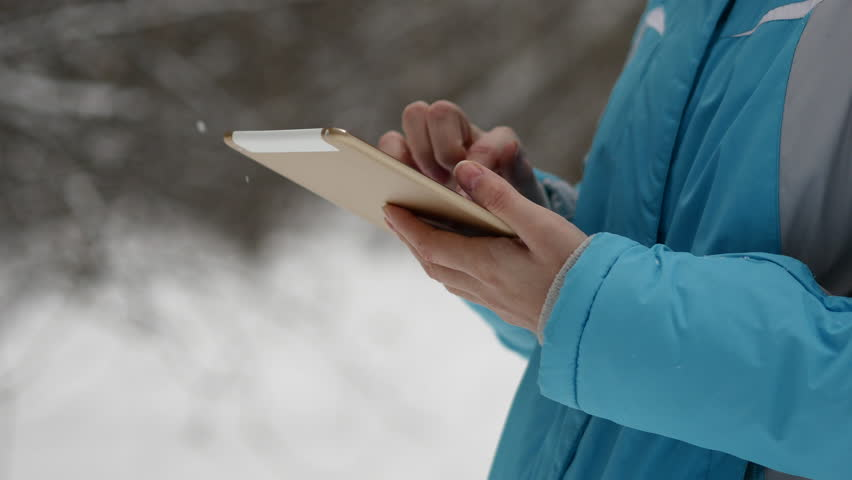 Woman Search On The Map In Tablet. Winter Forest, Snowy Weather Day | Shutterstock HD Video #21264844