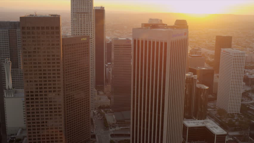 Aerial sunset view of downtown city skyscrapers in Los Angeles, California, USA.