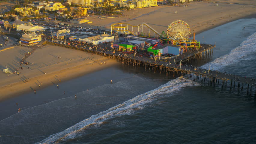 Aerial view of The Santa Monica Pier on January 1, 2012. Aerial view of The Santa Monica Pier ferris wheel, and amusement in Los Angeles, California, USA.