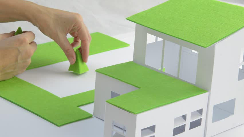 Architect At Work, Doing Final Improvements On A Model Of A Green House.  Closeup