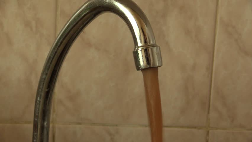 Stock Video Clip of dirty rusty water flowing from the tap ...