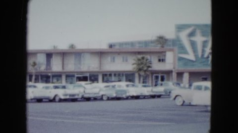 NEVADA 1958: public temporary residency parking lot occupied by multiple firstrate vehicles
