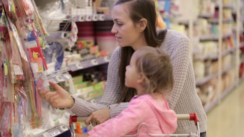 Mother and daughter shopping in supermarket. Mom and girl choosing goods for celebrate. | Shutterstock HD Video #21407674