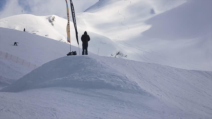 SOCHI, RUSSIA - APRIL 1, 2016: Snowboarder make high jump from springboard, slide on slope. Ski resort. Extreme. Slow motion | Shutterstock HD Video #21415534