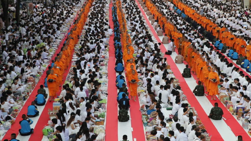 BANGKOK - MARCH 25: Monks are participating in a Mass Alms Giving of 12,600 monks in Central World for the Makha Bucha celebrations on March 25, 2012 in Bangkok, Thailand.