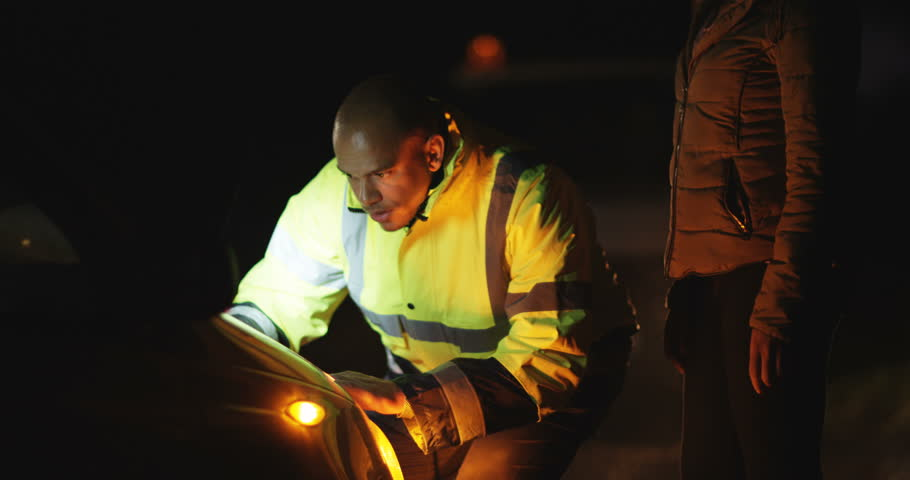 4k, Mechanic arrives to fix a broken down car to the relief of a female driver late at night.