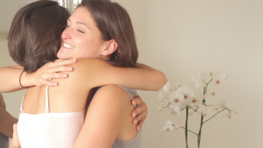Female friends hugging and kissing