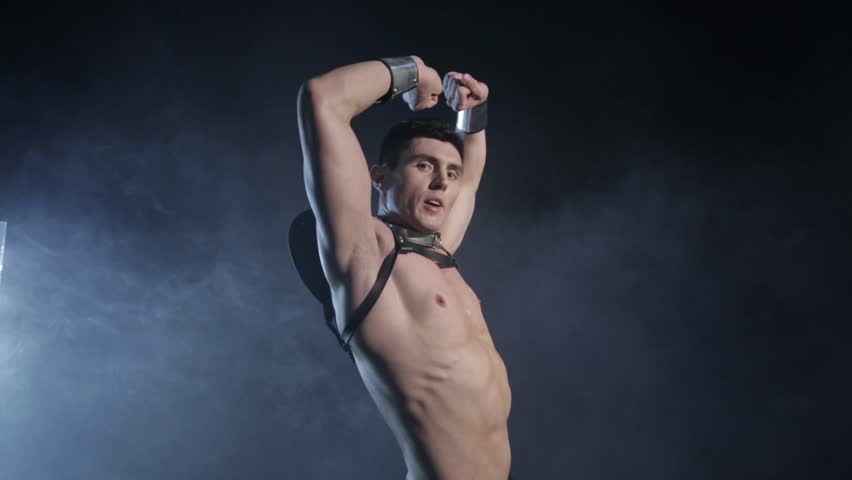 Sexy muscular man dance on dark background. Beautiful body. Sex and passion. Copy space text. No color correction.