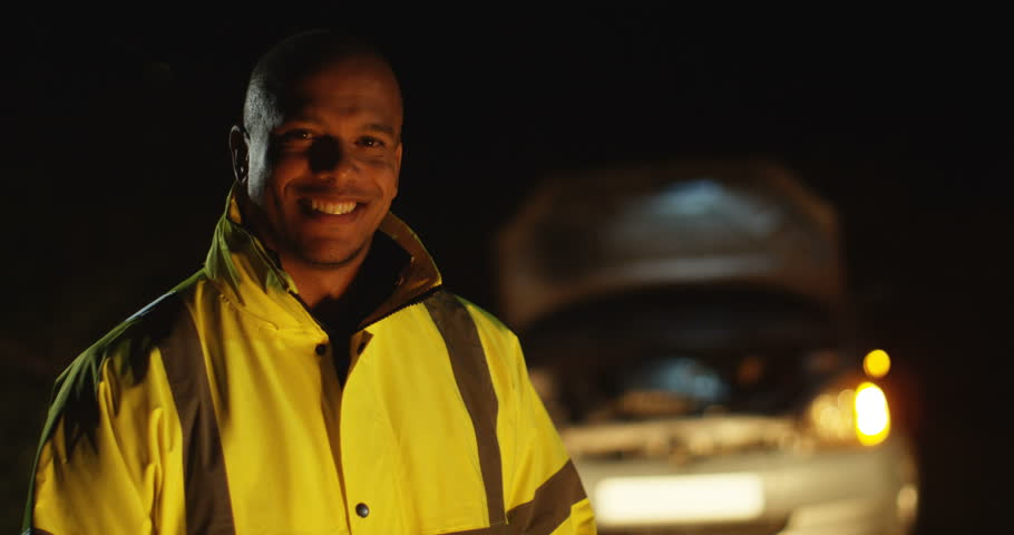 4k, Portrait of a cheerful male road side assistant happy to help. Slow motion.