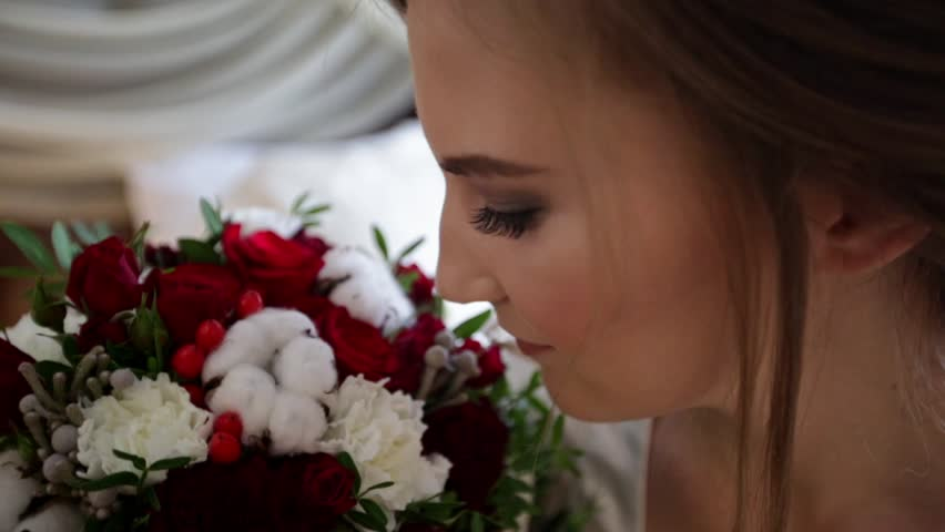 Young bride smell the flowers, and then looking at the camera #21489994