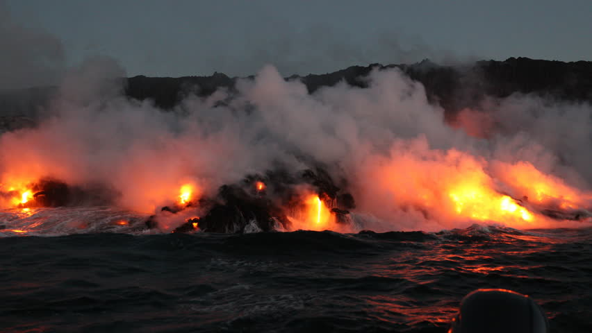 Lava running in the ocean from volcanic lava eruption on Big Island Hawaii. Seen from lava boat tour. Lava from Kilauea volcano by Hawaii volcanoes national park, USA. Dawn, steadicam, 59.94 FPS. 2016 | Shutterstock HD Video #21496054