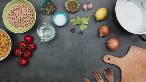 Chickpeas recipe preparation and cooking accessories. Top view on food ingredients. Stop motion animation.