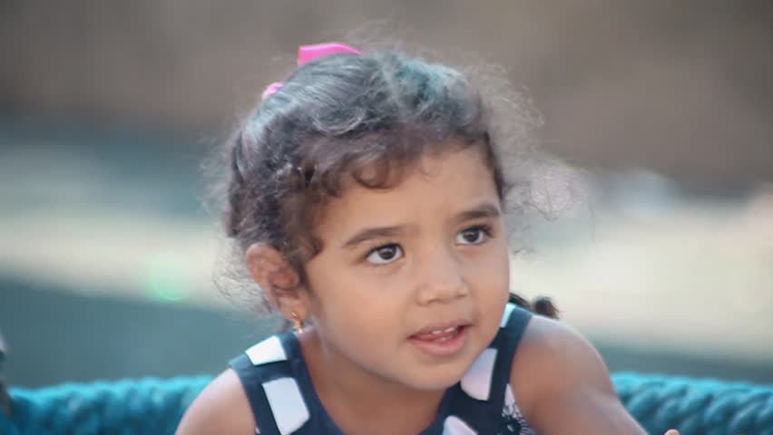 Pretty little girl smiling. Face close up.  Cute little girl smiling on a swing. Slow motion video | Shutterstock HD Video #21500404