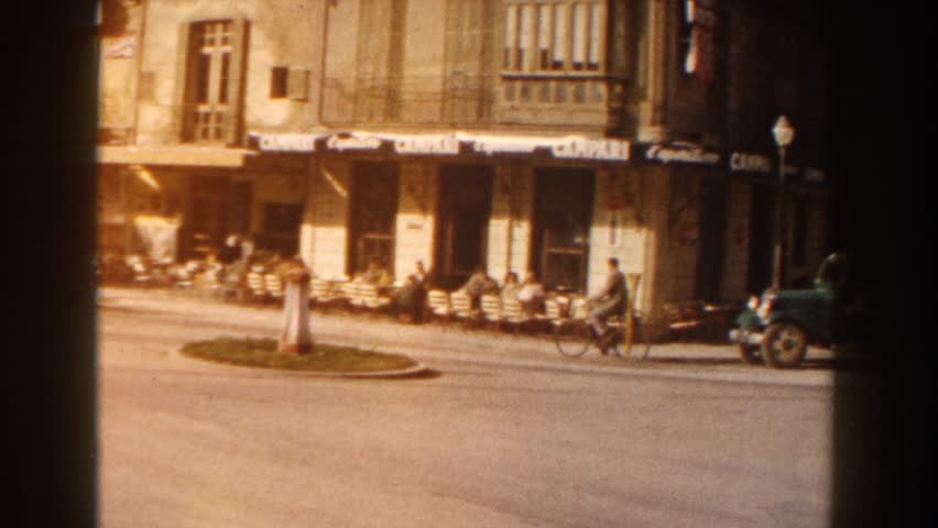 ITALY 1960: several men riding down the street using different modes of transportation