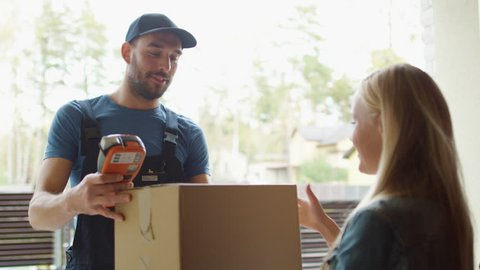 Homeowner Opens the Door to Delivery Man and Receives Parcel After Signing on Delivery Device. Shot on RED Cinema Camera in 4K (UHD).