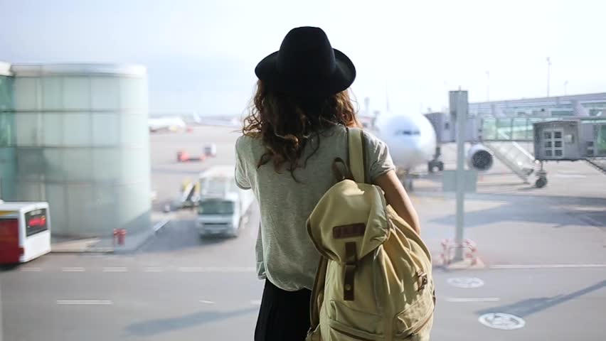 girl standing at the window in airport terminal. | Shutterstock Video #21546376
