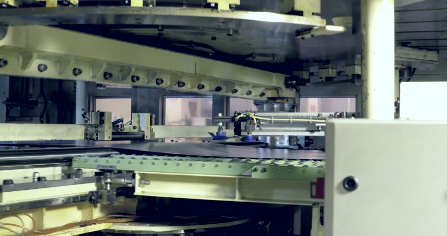 Robots are pressing metal sheet in production line in automobile factory   Shutterstock HD Video #21557884
