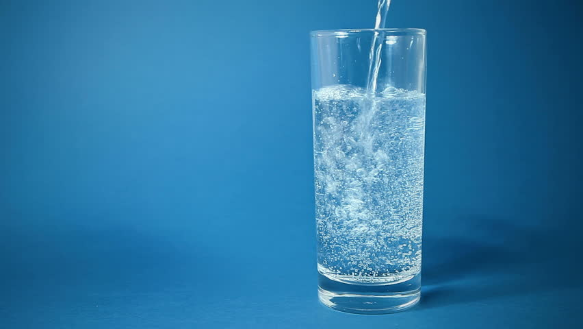 A Glass Full Of Sparkling Water On Black Background Stock