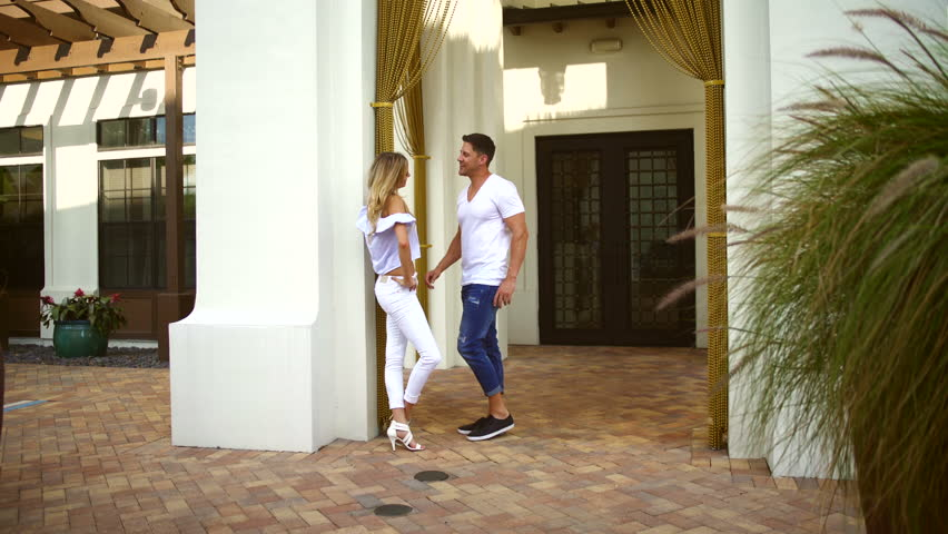 Attractive happy Caucasian American couple resort recreation meeting dating informal clothing fashion fun Summer vacation outdoors | Shutterstock HD Video #21574114