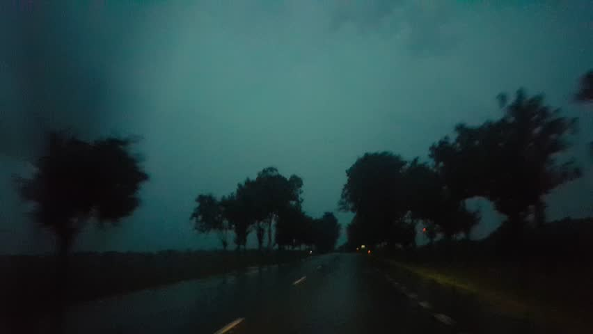 Pov driving a car at night in a rainy horrifying road with high speed