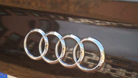 INGOLSTADT, GERMANY - CIRCA 2016: Panning to Audi sport car logotype ona luxury car. Audi is a German automobile manufacturer that designs, engineers, produces, markets and distributes luxury vehicles
