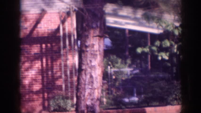 MEMPHIS TENNESSEE 1963: zoom out to see house with red bricks trees shady | Shutterstock HD Video #21611284
