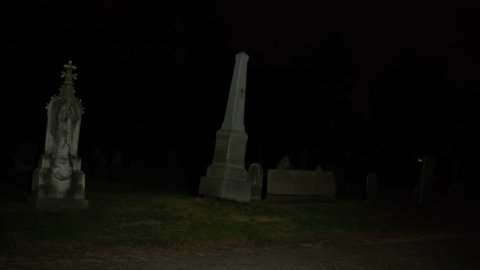 Cemetery graveyard at night dark graves headstones