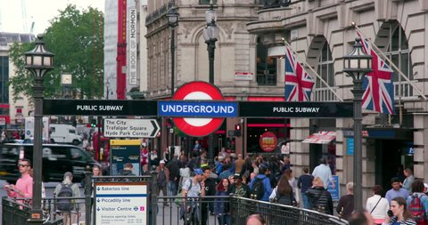 UNITED KINGDOM, LONDON - MAY 2016: Crowd & Underground Sign; Coventry Street London England