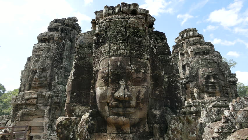 Stone faces at the Bayon temple at Angkor, Siem Reap, Cambodia. Panning right to left. #21685234