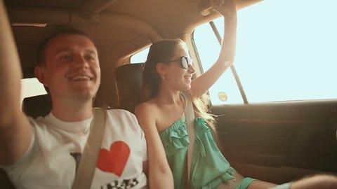 Desert Safari SUVs bashing through the arabian sand dunes. The girl and the guy in the car 3