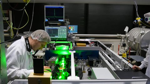DUSSELDORF, GERMANY - APRIL 16, 2016: Research group of the Laser and Plasma Physics Laboratory at the Heinrich-Heine-University. Doctoral students adjusting the experimental set-up.