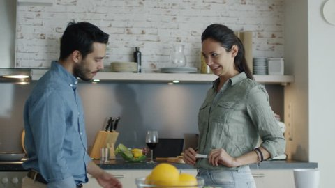 In the Kitchen Gorgeous Girl Shows Pregnancy Test Result to Her Boyfriend. Both Happily Embrace. Slow Motion. Shot on RED Cinema Camera in 4K (UHD).