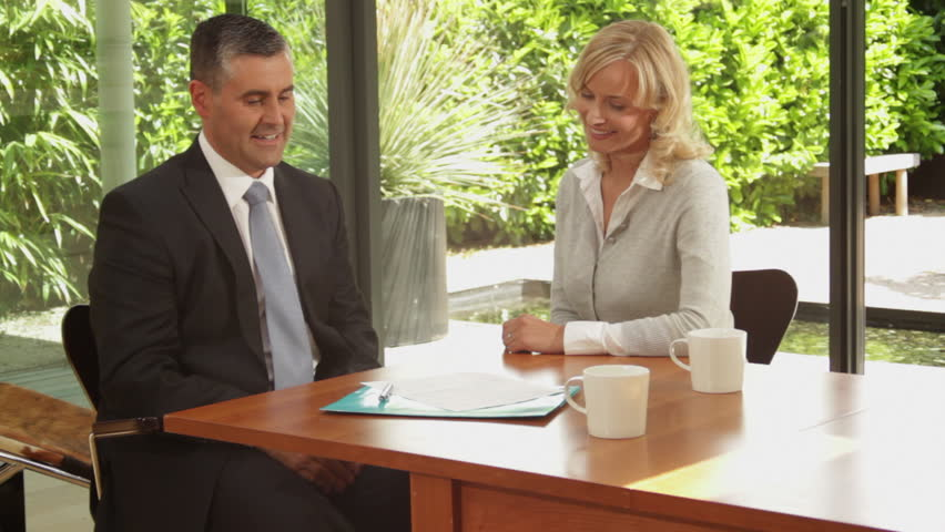 Medium shot off female signing contract at dinning table and handshake financial advisor   Shutterstock HD Video #2175332