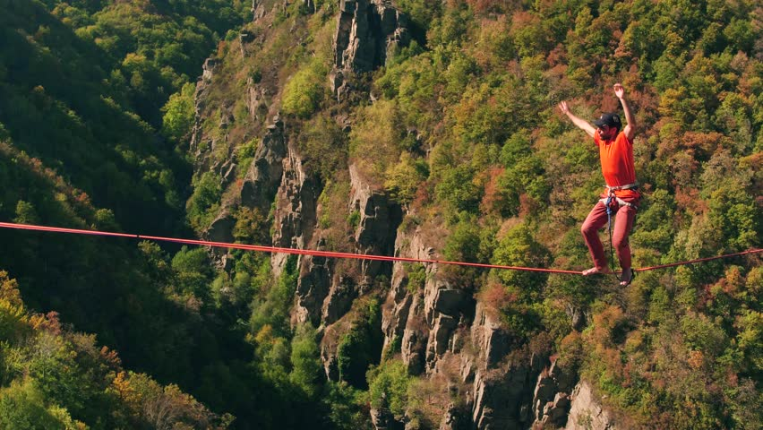 Drone Footage Of Brave Man Slacklining Over Mountains During Autumn Rope Extreme Sport Balance Danger Season Walking Adventure Travel Tree Safety Nature