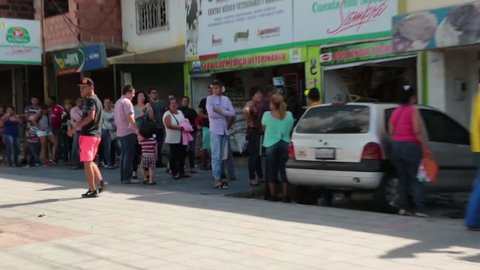 Cucúta, Colombia, Circa 2016: Pan past people waiting in a long line on street in Colombia  (HD)