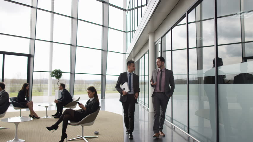 4K Businessmen Talking As They Walk Through Lobby Of Corporate Office Building UK Oct 2016 Stock Footage Video 21771874